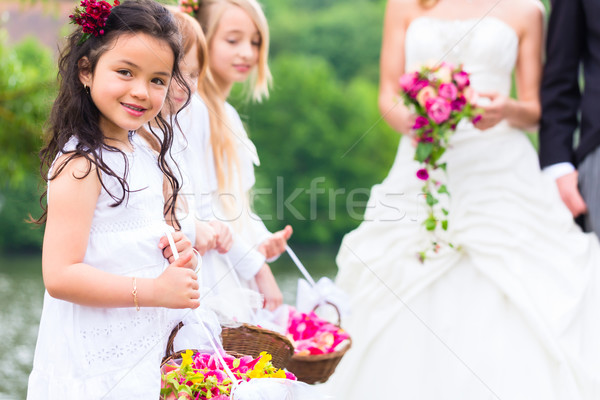 Wedding bride and groom with bridesmaid Stock photo © Kzenon