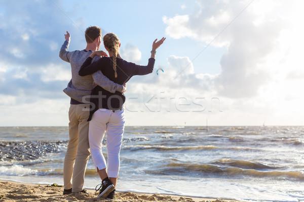 Couple in romantic sunset on ocean beach Stock photo © Kzenon