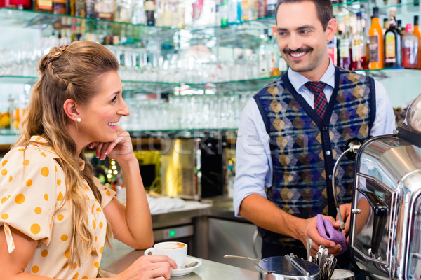 Girl in cafe or coffee bar flirting with barista Stock photo © Kzenon