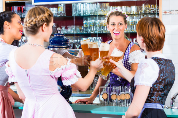 Innkeeper and guests drinking beer in Bavaria Stock photo © Kzenon