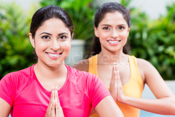 Two women in lotus position during yoga practice Stock photo © Kzenon