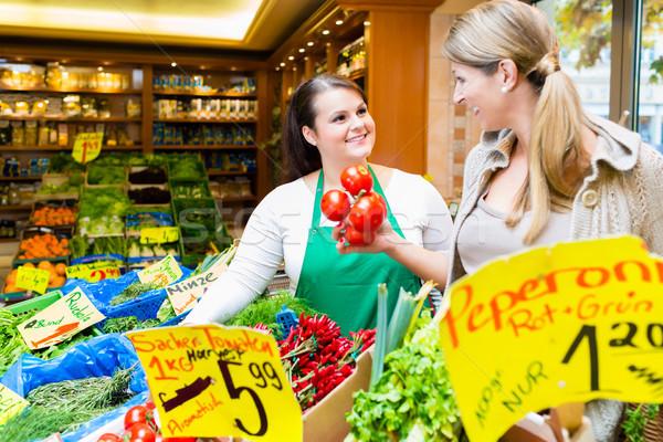 Saleswoman helping woman shopping groceries Stock photo © Kzenon