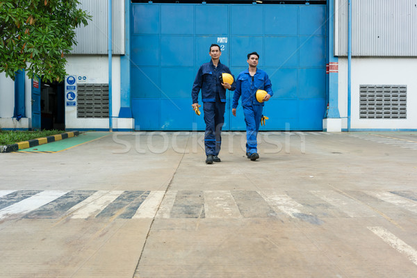 Two workers walking out from factory after work Stock photo © Kzenon