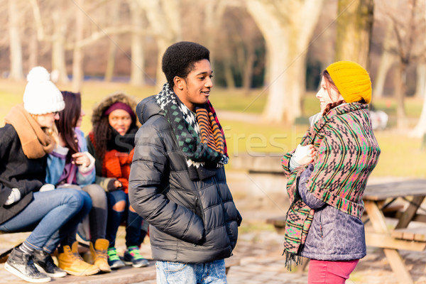 African American young man talking with female friend outdoors  Stock photo © Kzenon