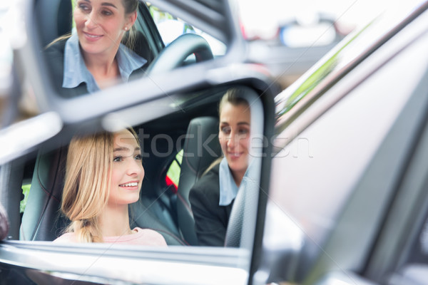 Student in driving school at the wheel of a car with her instructor Stock photo © Kzenon