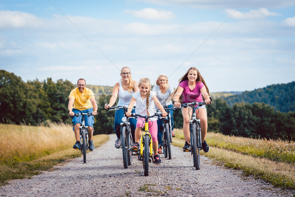 Stock photo: Family riding their bicycles on afternoon in the countryside