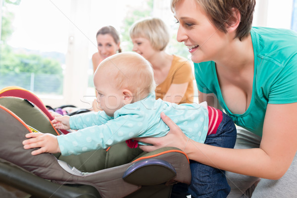 Moms and babies in mother and child course practicing Stock photo © Kzenon