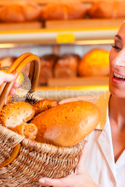 Salesperson with female customer in bakery Stock photo © Kzenon