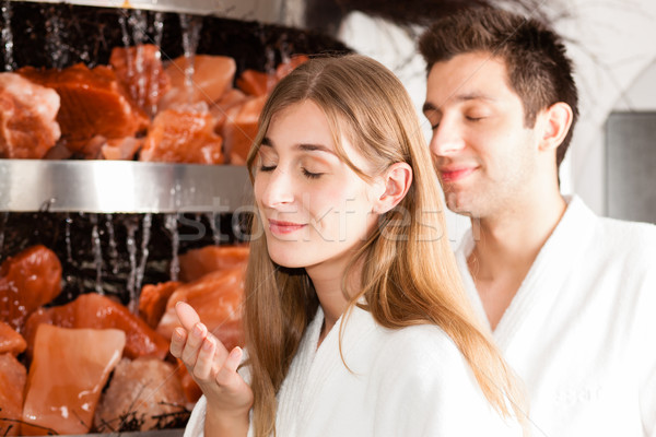 Young couple in salt cave of a Spa  Stock photo © Kzenon