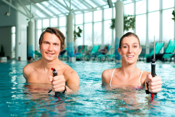 Fitness - sports and gymnastics under water in swimming pool or spa Stock photo © Kzenon