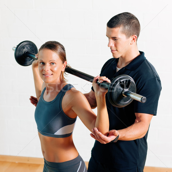 Personal Trainer in gym Stock photo © Kzenon