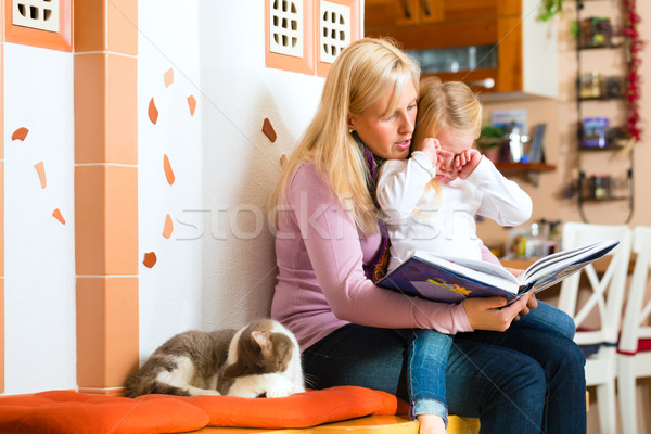 Stock photo: Mother reading night story to kid at home
