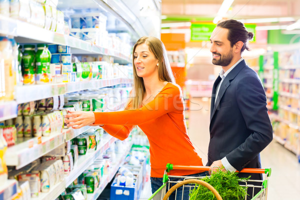 Couple selecting cooled products in hypermarket Stock photo © Kzenon