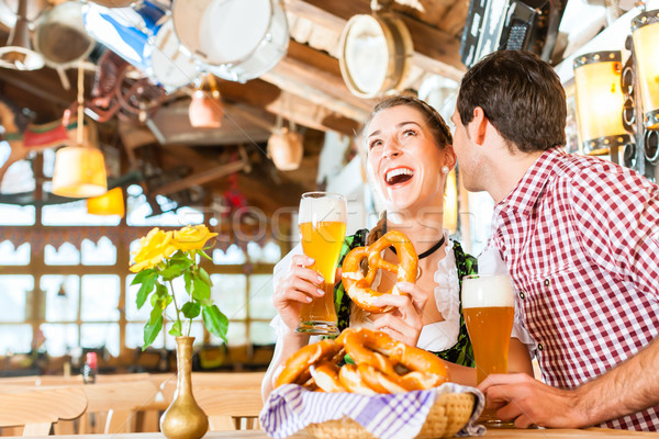 Couple drinking wheat beer in Bavarian restaurant  Stock photo © Kzenon