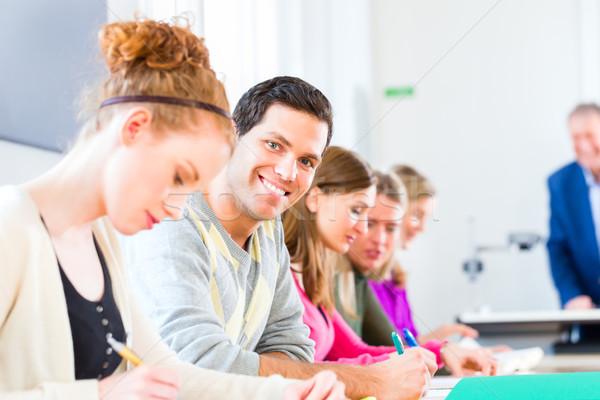 College students writing test Stock photo © Kzenon