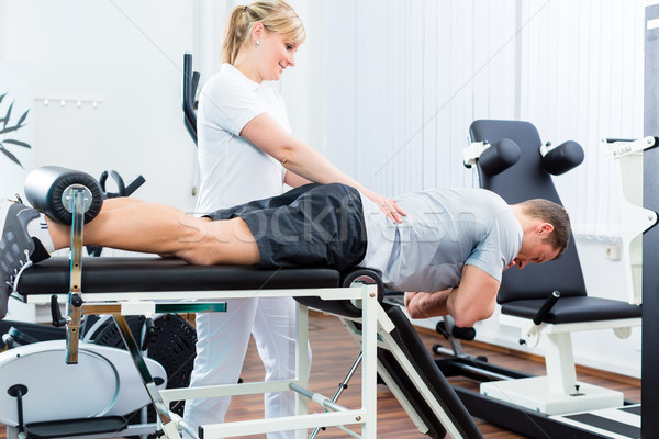 Physiotherapist or sport doctor with patient Stock photo © Kzenon