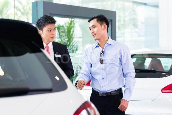 Stock photo: Asian Car Salesman selling auto to customer