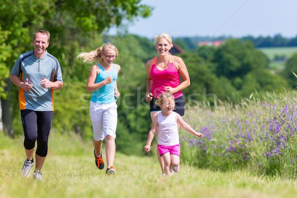 Family sport running through field Stock photo © Kzenon