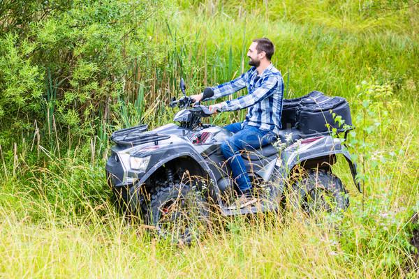 Man driving off-road with quad bike or ATV Stock photo © Kzenon