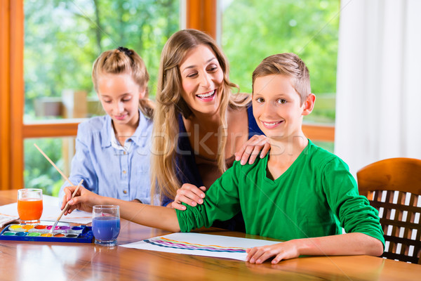Mother with kids painting pictures Stock photo © Kzenon