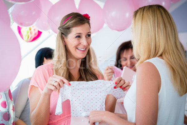 6871323 Woman Giving Gift To Pregnant Friend On Baby Shower By