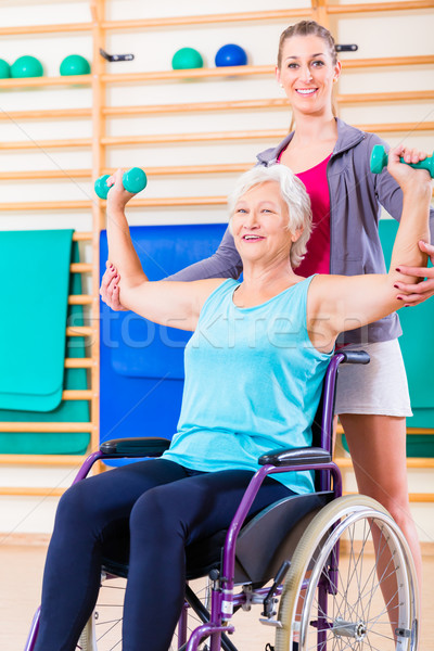Senior mulher roda cadeira fisioterapia treinador Foto stock © Kzenon