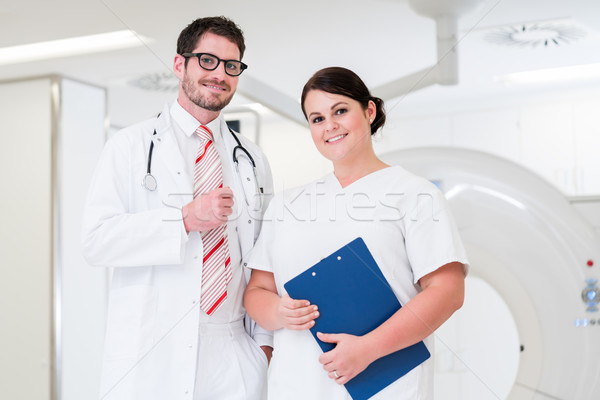 Doctor and nurse in front of CT scan machine Stock photo © Kzenon