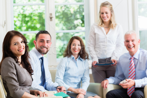 Business women and men in office having presentation  Stock photo © Kzenon