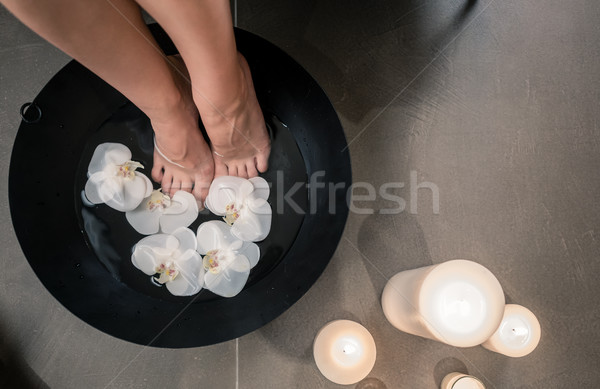 Female feet during Asian therapeutic washing at luxury beauty ce Stock photo © Kzenon