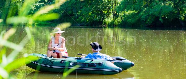 Casal barco lagoa lago pescaria mulher Foto stock © Kzenon