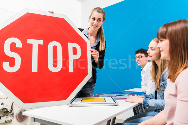 Driving teacher explaining meaning of street signs to class Stock photo © Kzenon