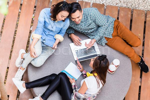 Three creative employees sharing ideas during brainstorming session Stock photo © Kzenon