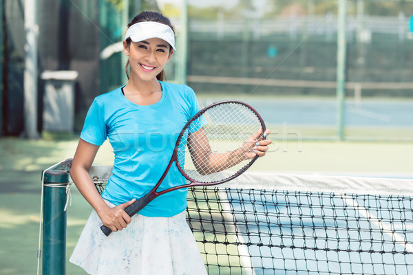 Portrait of a beautiful and competitive Asian tennis player Stock photo © Kzenon