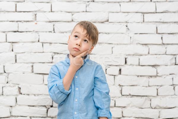 Pensive student thinking hard Stock photo © Kzenon