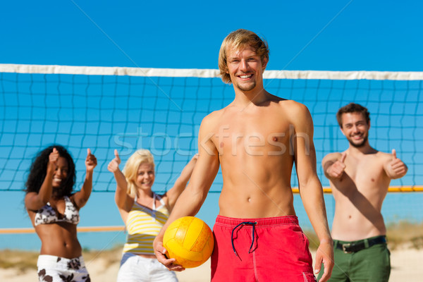 Friends playing Beach volleyball Stock photo © Kzenon