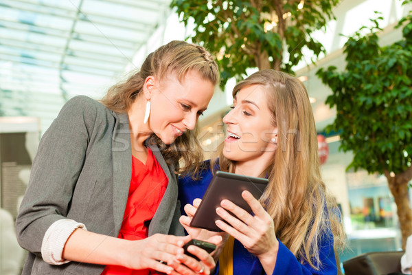 Two women shopping with bags in mall Stock photo © Kzenon