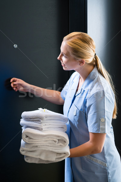 Service in the hotel, towels being changed Stock photo © Kzenon