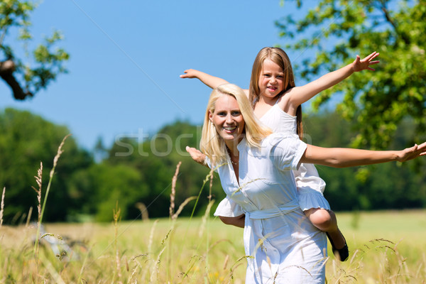 Stock photo: Mother with daugther in meadow