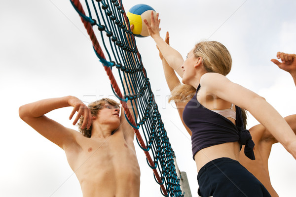 Plage volleyball joueurs été sport dangereux Photo stock © Kzenon