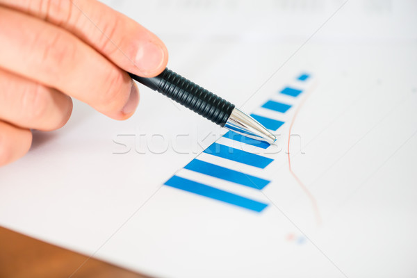 Business - Businessman working with chart and diagram Stock photo © Kzenon