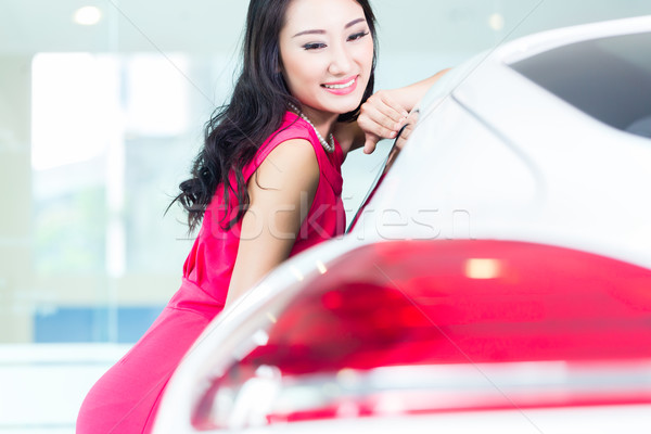 Asian Chinese woman buying SUV car Stock photo © Kzenon