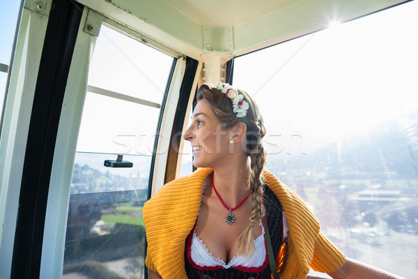 Woman in cable car going up the alp mountains Stock photo © Kzenon
