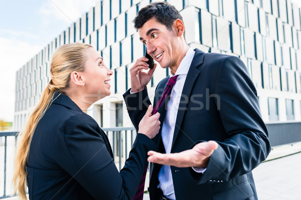 Flirt in the workplace - woman teasing man Stock photo © Kzenon