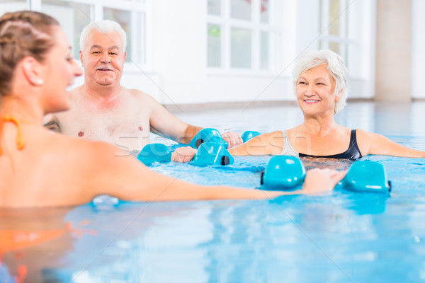 People at water gymnastics in physiotherapy Stock photo © Kzenon