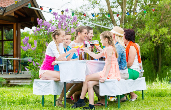 Family and neighbors at garden party drinking Stock photo © Kzenon