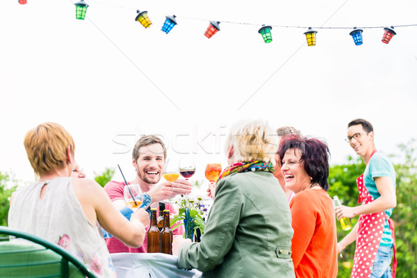 Friends and neighbors on long table celebrating party Stock photo © Kzenon