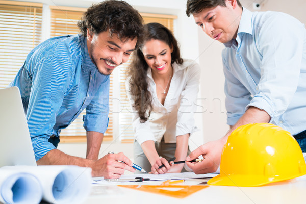 Civil engineers and architects talking about ground plot Stock photo © Kzenon