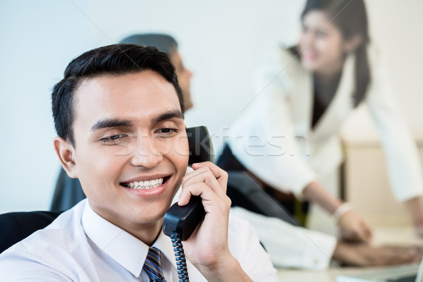 Employee in office making a business call Stock photo © Kzenon