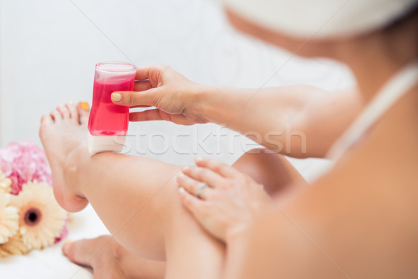 Hand of a young woman using a modern recharchable roll-on waxer  Stock photo © Kzenon