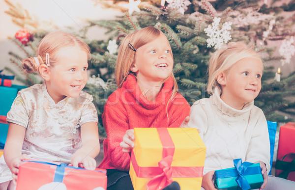 Christmas day in family, the Children unwrapping  presents Stock photo © Kzenon
